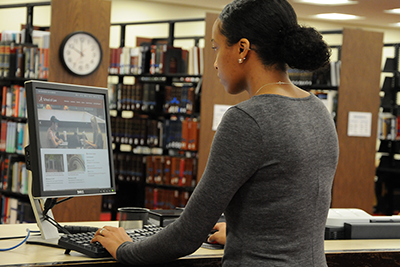 Woman using an online library catalog